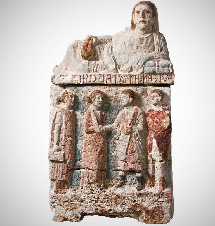 Urna funeraria etrusca con scena di commiato