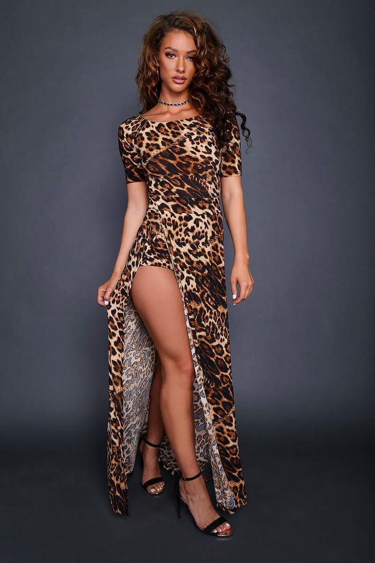 Get wild and funky with this outfit! This juniors romper features a double-slit maxi skirt overlay attached to the romper shorts and bold leopard print designs on the fabric. Also includes a fitted waistline and short sleeves.