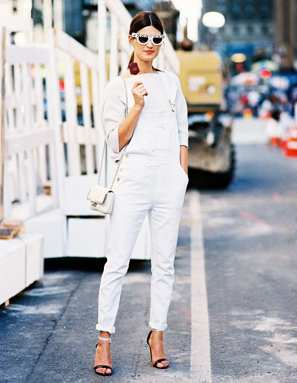 White cuffed overalls worn with black ankle strap heels and white blouse