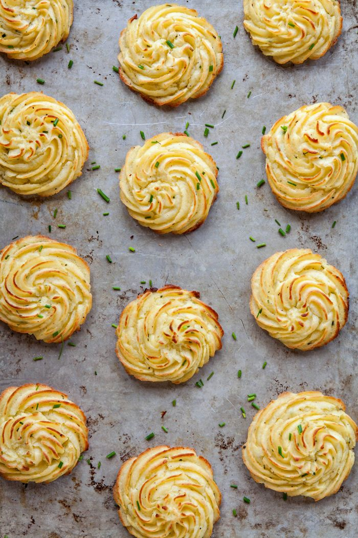 Cream Cheese Chive Duchess Potatoes are delicious, individually portioned mounds of mashed potatoes that have been baked. Inside they're creamy and fluffy while the outside is beautifully golden and crisp. Delicious Thanksgiving side dish!