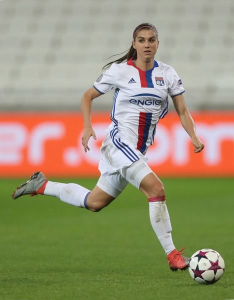 Alex Morgan Photos Photos - Alex Morgan of Olympique Lyon in action during the Women's Champions League match between Lyon and Wolfsburg at Stade de Lyon on March 29, 2017 in Lyon, France. - Lyon v Wolfsburg - Women's Champions League