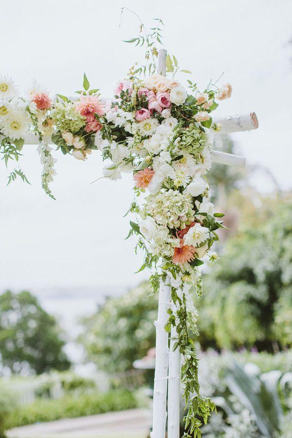 floral ceremony arch - photo by I Love Wednesdays http://ruffledblog.com/flower-filled-bohemian-australian-wedding #weddingceremony #ceremonies
