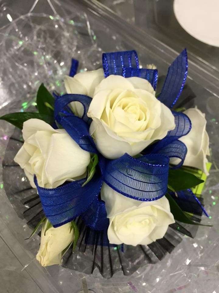 Wristlet corsage with white spray roses, royal blue ribbon and black accents. #prom #corsage #wristlet #flowers #theflowershopfairoaks