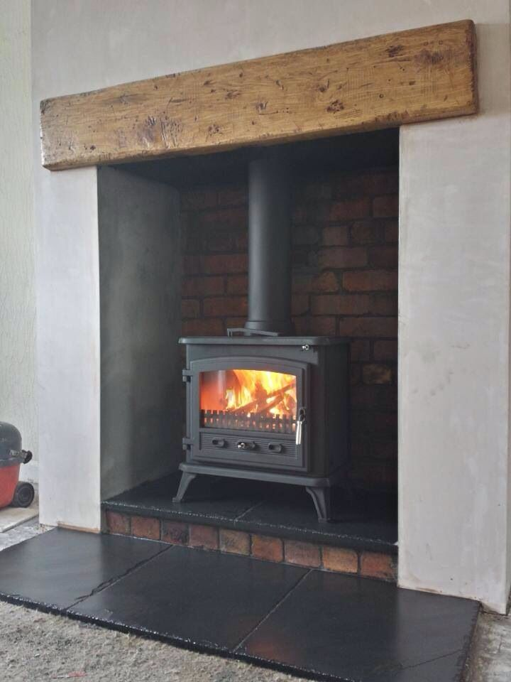 Wood burner with oak beam