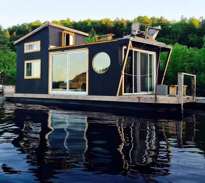 Winterproofed houseboat with a rooftop deck is a tiny hotel on the river