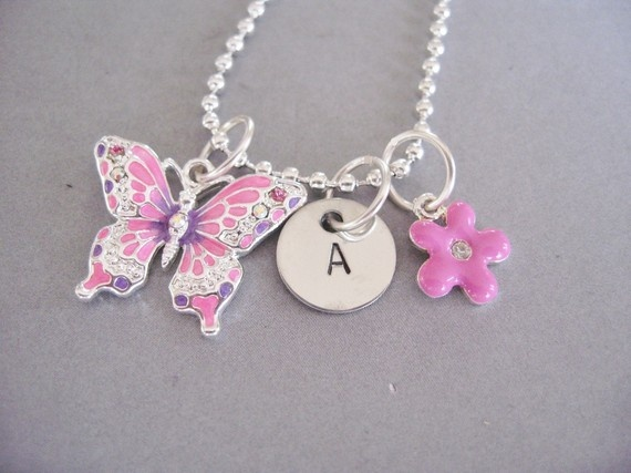 Personalized Butterfly Blossom charm necklace from the belle bambine children's line. This silver, pink, and purple necklace will make every little girl feel as though they blossomed into a beautiful butterfly!