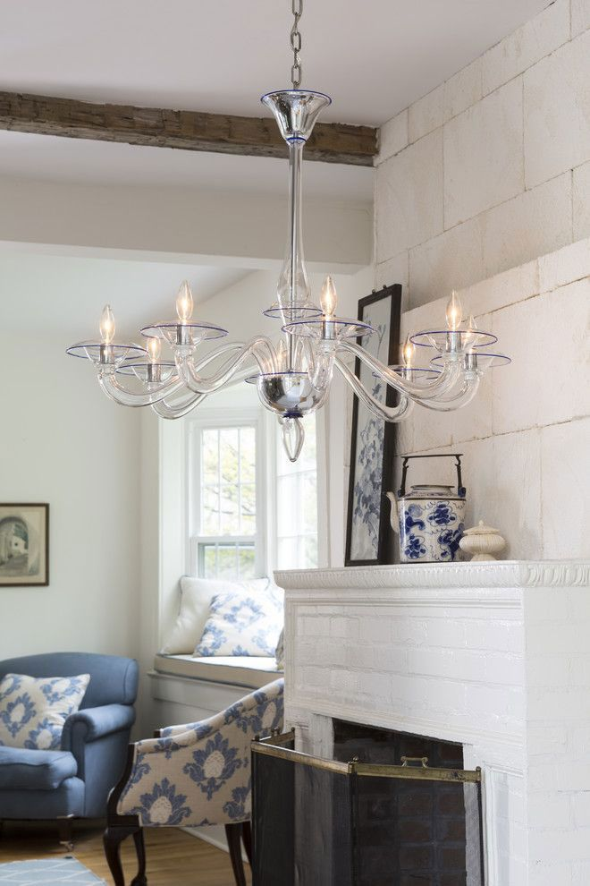 hand-blown clear Venetian glass chandelier with blue trim; blue and white room decor with Murano glass chandelier; home lighting ideas;