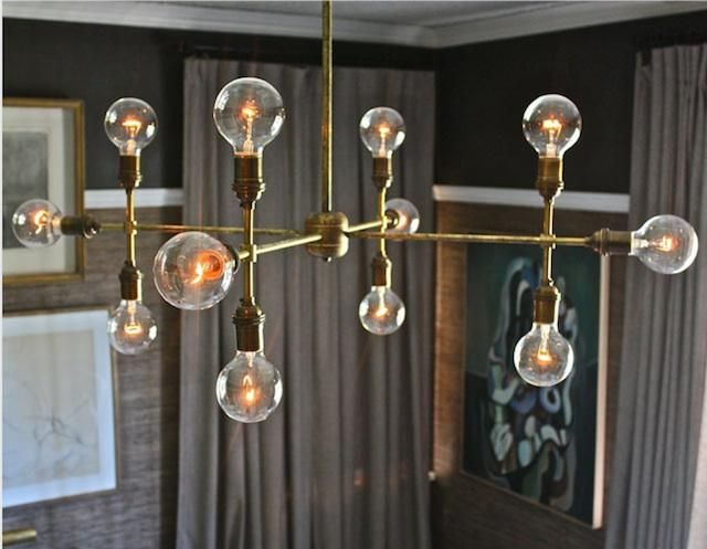 Custom Brass Compass Chandelier was inspired by cartographic imagery; contact Gallery L7 for pricing.