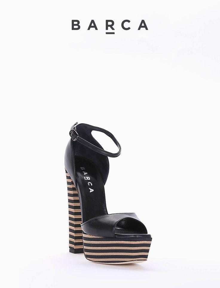 #Sandalo #tacco 14cm , plato 4cm . Particolarissima struttura del #tacco e del #plateaux in fasce di #cuoio alternato a gomma. Punta #squadrata e cinghietta in caviglia.  COMPOSIZIONE FONDO CUOIO, SOLETTO VERA PELLE  COLORE #NERO  MATERIALE #PELLE