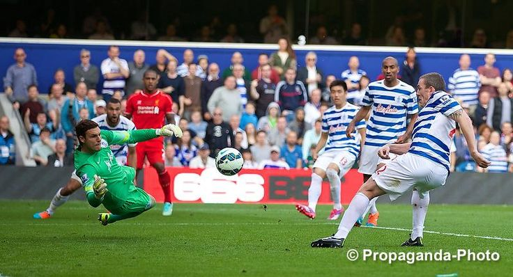 Queens Park Rangers' Richard Dunne scores a tap-in for Liverpool, 1-0, og.