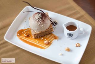 Blondie with coffee semifreddo, caramel sauce and candied peanuts /Plate dessert/