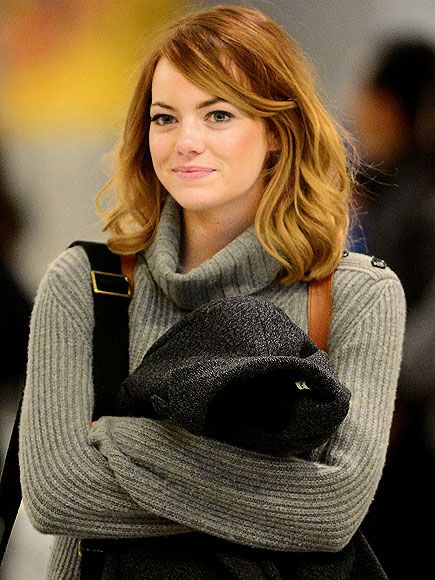 With her Golden Globes presenting gig behind her, Emma Stone is back to New York City on Monday afternoon, arriving to New York's JFK Airport in a cozy sweater.