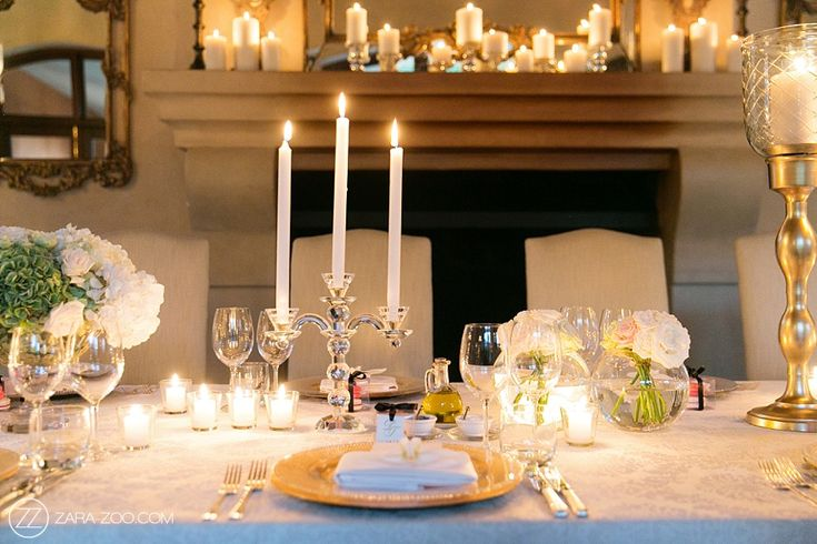 Wedding reception table decor. Gold under plates, soft flowers, roses, candles, macaroons.