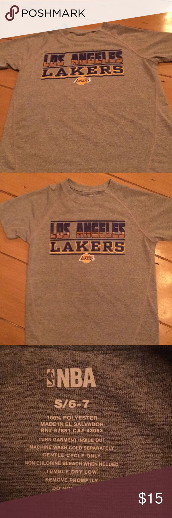 Los Angeles Lakers T-shirt This is a new without tags NBA  Los Angeles Lakers T-shirt made out of 100 % polyester. It is a very soft T-shirt. It is a size 6 –7/small and is gray. The threading that you can see in the picture shows that is a higher quality than a basic cheap T-shirt. Look at my other items for possible bundling NBA Shirts & Tops Tees - Short Sleeve