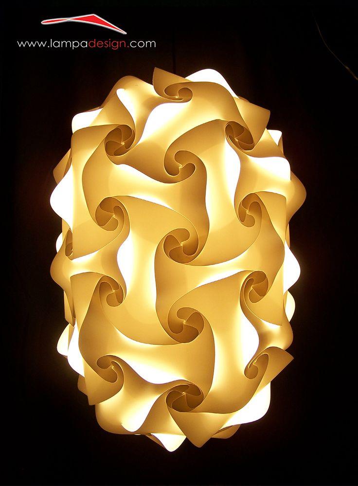 Lampada o Lampadario GIOIA. Lo trovi qui: http://www.lampadesign.com/scheda.php?id=29 E' una sorgente di luce con la sua forma e i  suoi incredibili effetti di luce. Ricorda lo scorrere di una cascata  E' possibile posizionarla anche in senso orizzontale  Scegli i colori che più ti piacciono e te la costruiremo come tu la desideri !