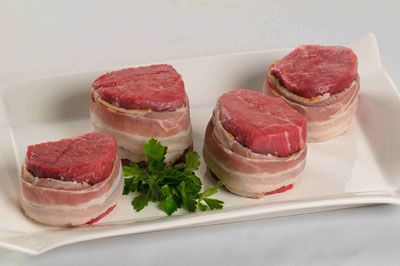 Mouthwatering seven ounce bacon wrapped beef tenderloin filets. Center cut.  4-7 oz Bacon Wrapped Filets  Bacon Wrapped Filets  Price: $49.9...