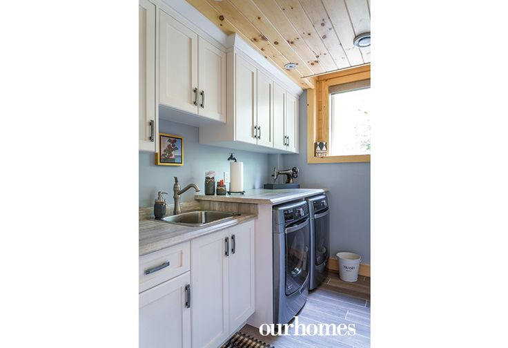 The laundry room is located on the lower level and features imported porcelain flooring.   http://www.ourhomes.ca/articles/build/article/viceroy-cottage-becomes-recharging-retreat?full=true#sthash.Rnu855dl.dpuf