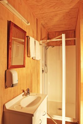 Eco Chalet | Russell - Orongo Bay Holiday Park. One of the en suite bathrooms in the Eco Chalets.
