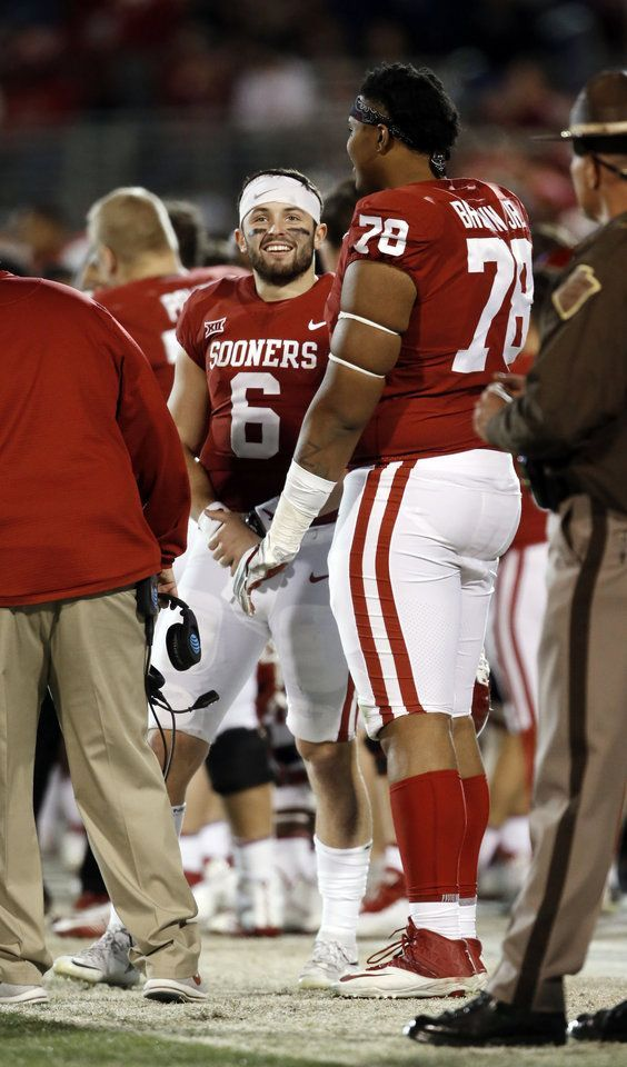 Oklahoma's Baker Mayfield (6) and Orlando Brown (78) talk on the sidelines during a college football game where the University of Oklahoma Sooners (OU) defeated the West Virginia Mountaineers 59-31 at Gaylord Family-Oklahoma Memorial Stadium in Norman, Okla., on Saturday, Nov. 25, 2017. Photo by Steve Sisney, The Oklahoman