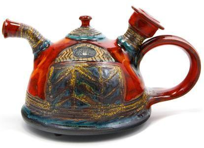 Google Image Result for http://homeinteriordesignthemes.com/wp-content/uploads/2009/12/bulgarian-ceramic-tea-pot-danko-colorful.jpg