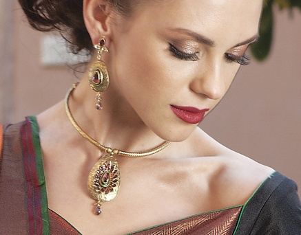 Necklace and earrings antique gold finish with rhodolite stone in hasli style by Benzer priced at $249. Buy online at www.benzerworld.com