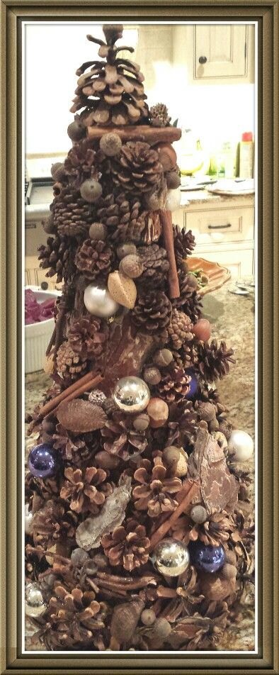 Christmas tree made with pinecones acorns nuts sticks