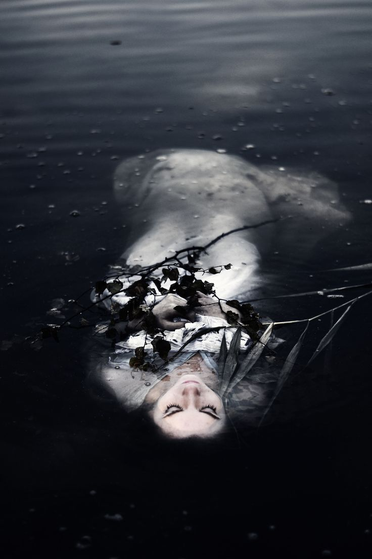 This is what I envisioned the people who found Ophelia would have saw in Act 4 Scene 7 when she drowned herself. Her skin would have been so pale and light and she would be floating among branches and leaves.
