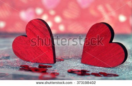 Decorative red wooden hearts and festive lights - stock photo