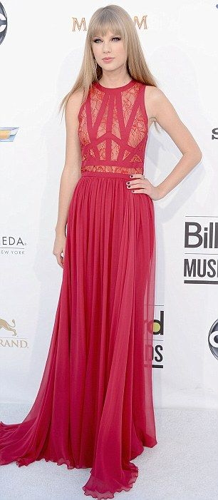 All grown up! Taylor Swift shows she is worthy of the Billboard Woman of the Year award as she attends the ceremony in a vampish red dress