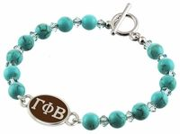 Swarovski Turquoise Beads, and Swarovski Crystals are combined to create our Gamma Phi Beta Bracelet. The Sorority bracelet top is cast in solid sterling silver and hand finished to achieve maximum detail. The Turquoise beads are Swarovski dyed Howlite with a bright Turquoise color and a hint of natural looking matrix. The accent beads are genuine Swarovski Crystal in a clean Aqua color. Designed by sorority sisters for a fresh clean look. Made in the U.S.A.Metal: Sterling SilverBra