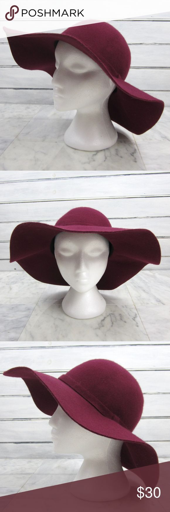 "Burgundy Wool Wide Brim Floppy Oversize Cloche Hat Ladies burgundy 100% felt wool wide brim floppy cloche hat! Features a rounded upper, a 4 3/8"" brim and a subtle banding at the upper. Sits beautifully, classic and elegant style! Unlined, 100% wool felt, beautiful dark burgundy purple in color. Unbranded, made in China.  Size is marked ""One Size"". Interior circumference measures 22"" approximately.   Condition: Excellent condition overall, only worn a few times-no visible signs of notable…"