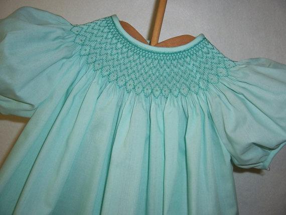 Soft aqua dress with dark aqua hand smocking Size 3 year    {via SmockedBayou Etsy}