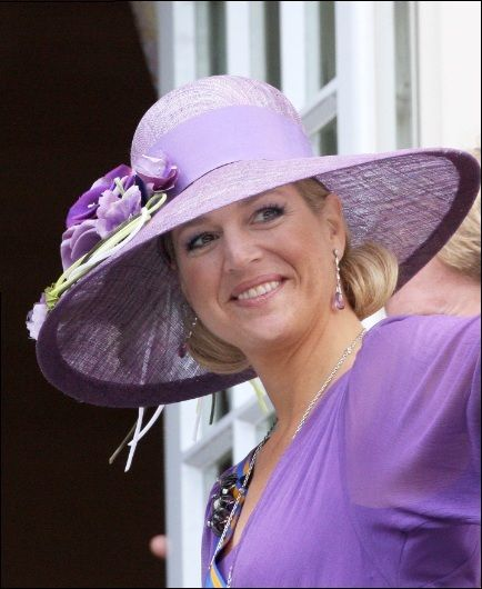 Queen Maxima in a beautiful lavender wide brim. Hat designed by berryrutjes milliner.