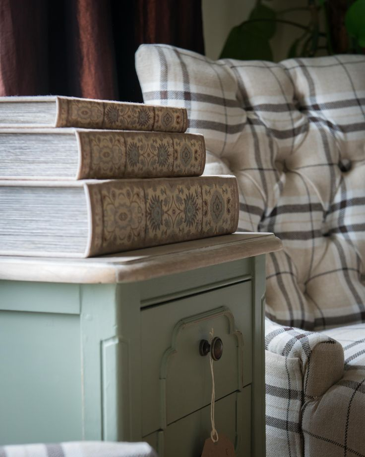 tartan armchair, orchard green locker, and 3 book boxes stacked
