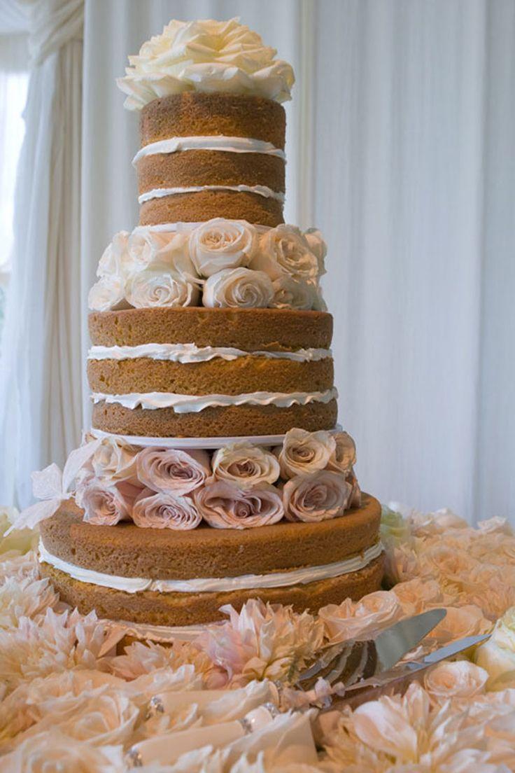 Hilary Duff's wedding cake with white roses.  http://ksassets.timeincuk.net/wp/uploads/sites/46/2015/11/HILLARY-DUFF-WEDDING-CAKE.jpg