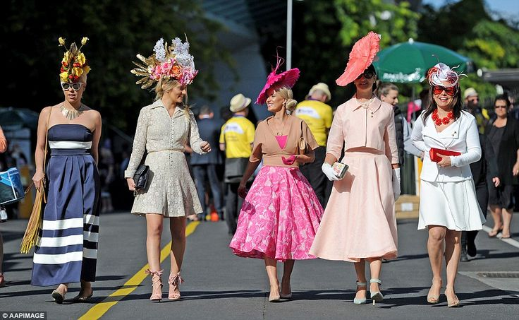 Keen racegoers: Glammed up race-lovers flowed into Flemington ahead of the iconic Melbourne Cup race from 8.30am
