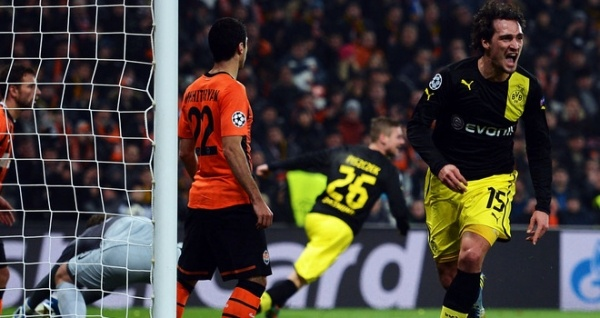 Borussia Dortmund progressed to the quarterfinals of the Champions League with an impressive 3-0 victory over Shakhtar Donetsk at the Westfalenstadion.