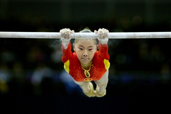 Kexin He Photos Photos - Kexin He of China competes in the uneven bars during the Apparatus Finals on the fifth day of the Artistic Gymnastics World Championships 2009 at the O2 Arena on October 17, 2009 in London, England. - Artistic Gymnastics World Championships 2009 - Day Five