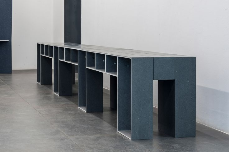 Max Lamb used waste cotton and wool to create 12 benches for an installation at Milan design week by materials brand Really