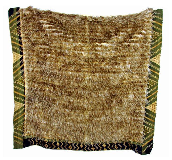 Kiwi feather cloak with a deep taniko border, kiwi feathers and