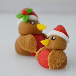 Fondant Robins - wings made from a rose leaf cutter! - For all your cake decorating supplies, please visit craftcompany.co.uk