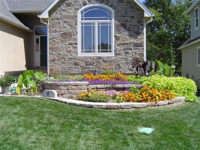 attractive and functional two level retaining wallflower bed uses slope to great advantage