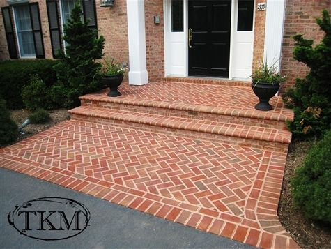 Mortared herringbone brick porch and landing with bullnose treads by Kings Masons, via Flickr