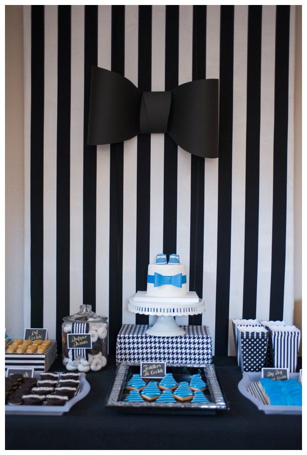 A dapper 1st first birthday boy party sweets, cookie and cake bar display. Pinstripes, bowties, ties patterns and tuxes. Black, white, blue and gold each dessert was loved by the kids. Popcorn, cakes, sugar cookies, dognuts, ding dongs and oreos!!!