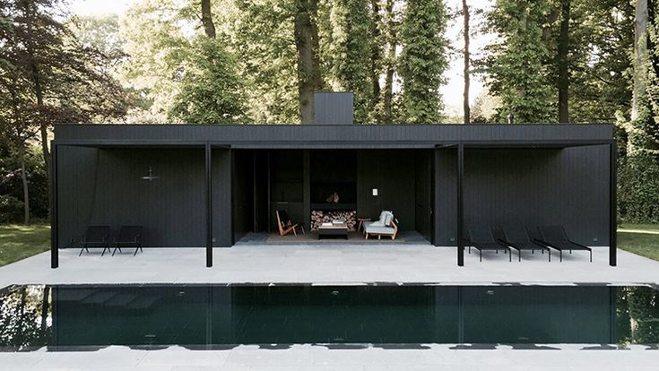 This black timber clad pool house by Belgian designer Marc Merckx strikes the perfect balance between proportions, materials and space.
