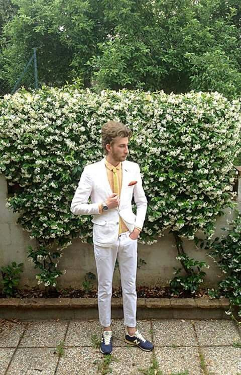 White suit and New Balance shoes
