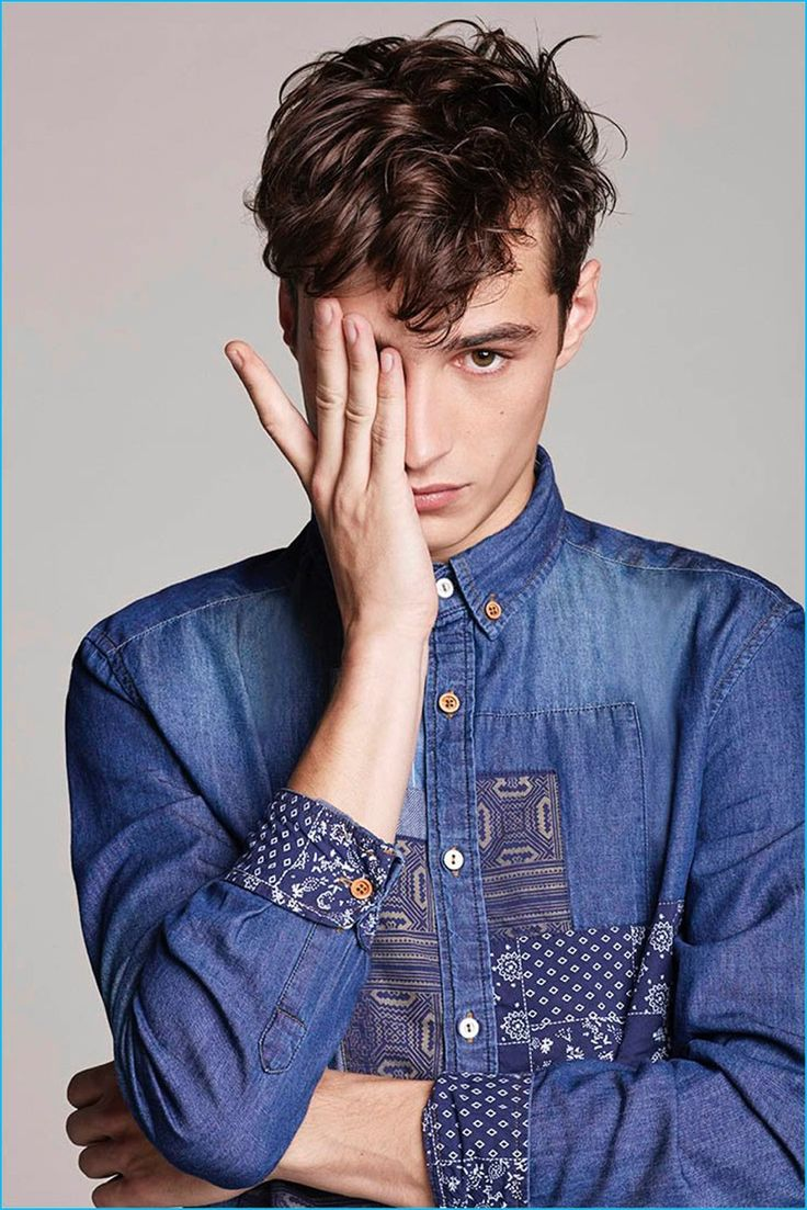 Adrien Sahores pictured in a distressed denim shirt from Desigual's new men's…