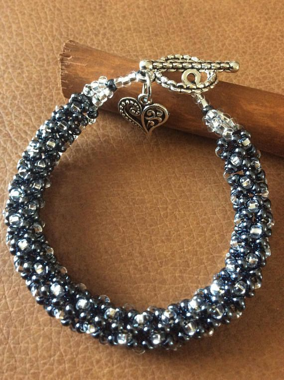 Metallic blue and silver beaded bracelet with heart charm This handcrafted piece of fashion jewelry will be a great addition to your unique jewelry collection or a perfect and wonderful gift for a very special person. It can be a part of everyday elegancy, but I also recommend it