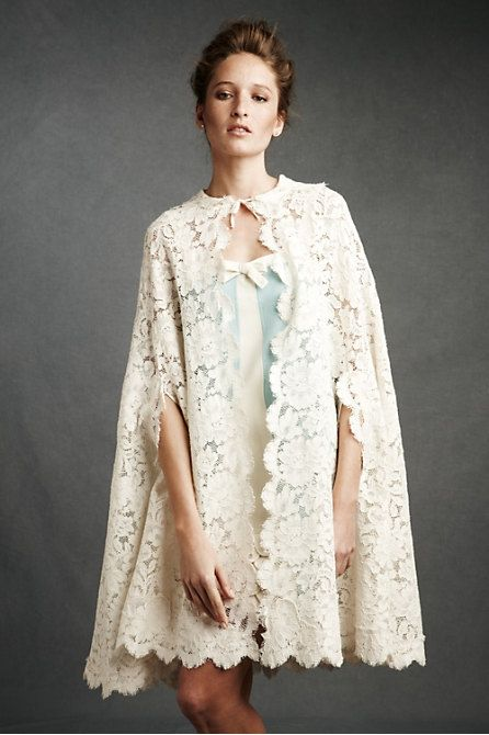 A lace cape cover up perfect for a vintage inspired wedding.