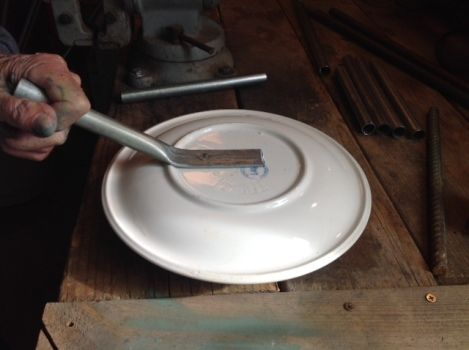 Linda Gerstner shows how conduit or aluminum pipe can be hammered flat and glued to plate for a stem.